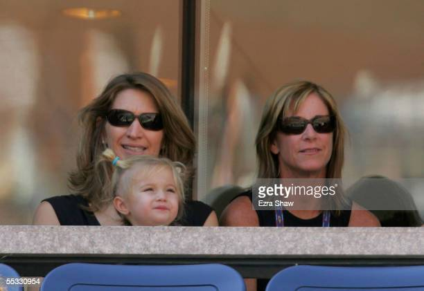Steffi Graf wife of Andre Agassi sits with their daughter Jaz Elle on her lap as she and a friend watch Agassi take on Robby Ginepri in the...