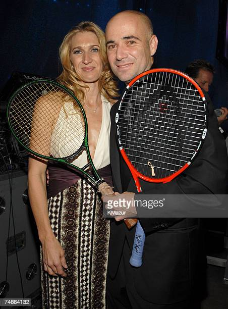 Steffi Graff and Andre Agassi holding Andre's first tennis racket when he went pro and his last tennis racket from US Open during the The Andre...