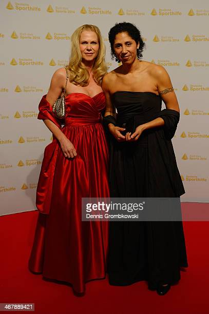 Steffi Jones and partner Nicole Parma pose on their arrival at the Ball des Sports 2014 at RheinMainHalle on February 8 2014 in Wiesbaden Germany