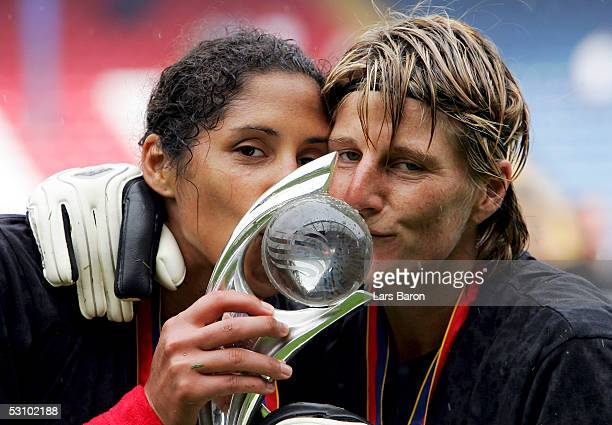 Steffi Jones and Silke Rottenberg from Germany kiss the cup after the UEFA Womens Euro 2005 Final between Germany and Norway on June 19 2005 in...