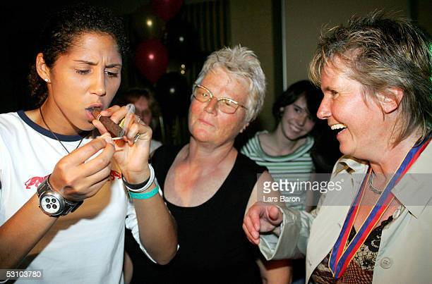 Steffi Jones and Tine Theune Meyer smoke a cigar during the champions party of the German National Team at the UEFA Women's Euro 2005 on June 19 2005...