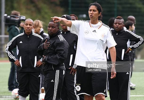 Steffi Jones director of German Football Association gives instructions during a training session at the NFV football school training ground on...