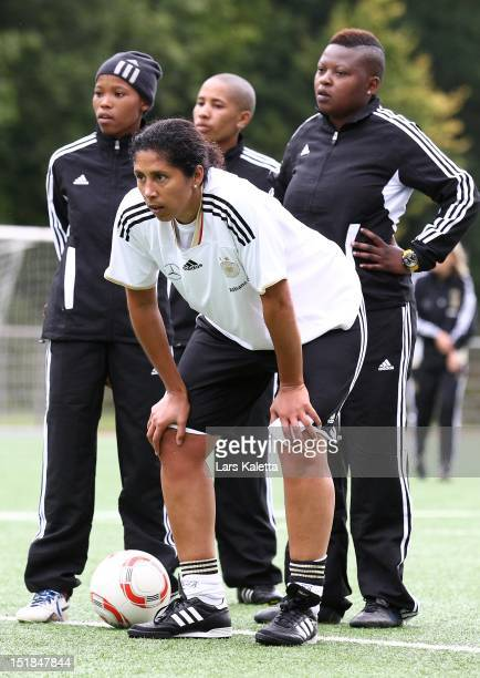 Steffi Jones director of German Football Association looks on during a training session at the NFV football school training ground on September 12...