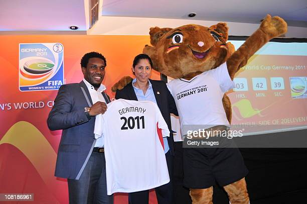 Steffi Jones , FIFA Women's Organising Committee President, poses with Jayjay Okocha and mascot Karla Kick during a press conference of the FIFA...