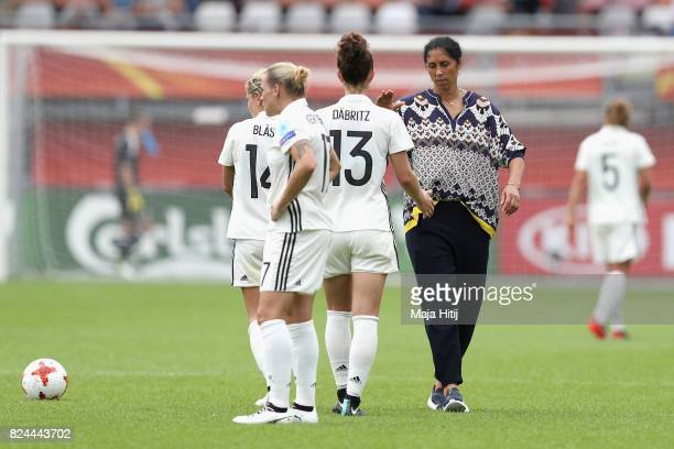 Steffi Jones head coach of Germany speaks to Sara Dabritz of Germany after the UEFA Women's Euro 2017 Quarter Final match between Germany and Denmark...