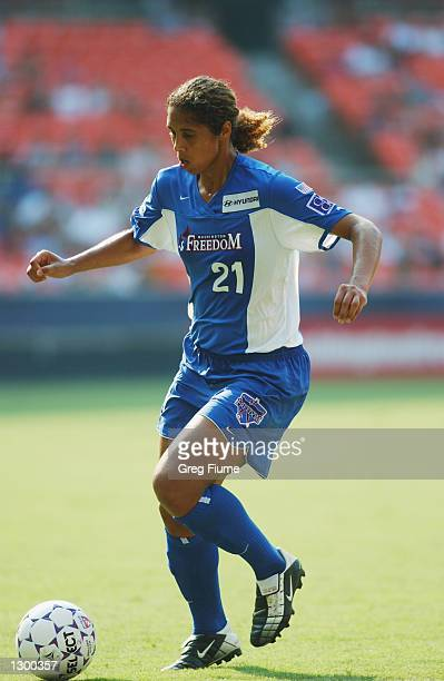Steffi Jones of the Washington Freedom dribbles the ball during the WUSA game against the Atlanta Beat on August 4 2002 at RFK stadium in Washington...