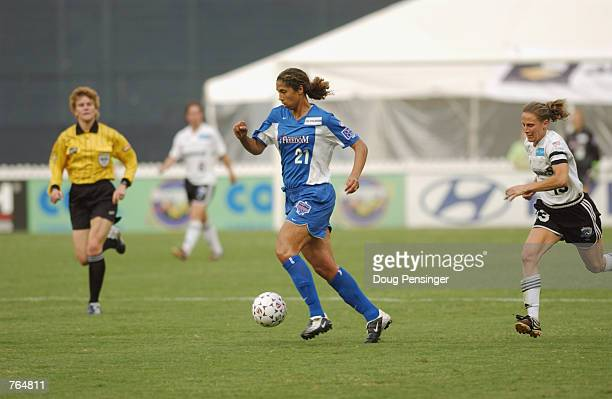 Steffi Jones of the Washington Freedom dribbles the ball with Kristine Lilly of the Boston Breakers in pursuit during the WUSA match on June 12 2002...