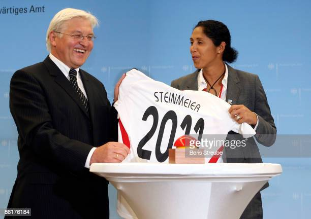 Steffi Jones president LOC of FIFA Women's World Cup 2011 hands over a jersey of the German women's national team to German ViceChancellor and...
