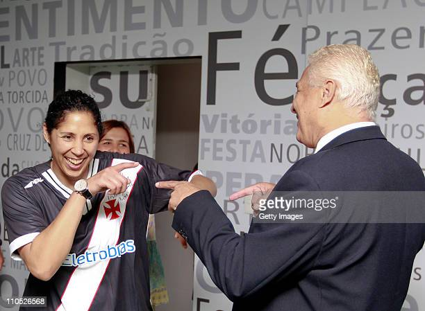 Steffi Jones President of Organizing Committee for the FIFA Women's World Cup 2011 jokes with Roberto Dinamite President of Vasco during a meeting as...