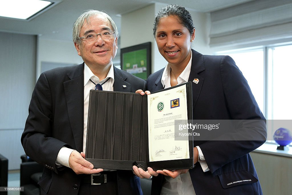 Steffi Jones (R), President of the Women's World Cup 2011 German Organizing Committee, and Junji Ogura, President of the Japan Football Association (JFA), pose after a Memorandum of Understanding (MOU) signing ceremony between the German Football Association (DFB) and JFA as part of the FIFA Women's World Cup Germany 2011 Welcome Tour at JFA House on June 8, 2011 in Tokyo, Japan.