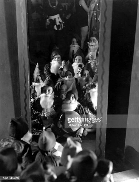 Steffi Nossen School of Dance Dance students checking their Santa Claus masks in front of a mirror 1931 Photographer James E Abbe Published by...