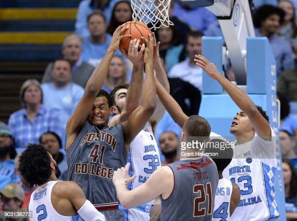 Steffon Mitchell of the Boston College Eagles batles Luke Maye of the North Carolina Tar Heels for a rebound during their game at the Dean Smith...