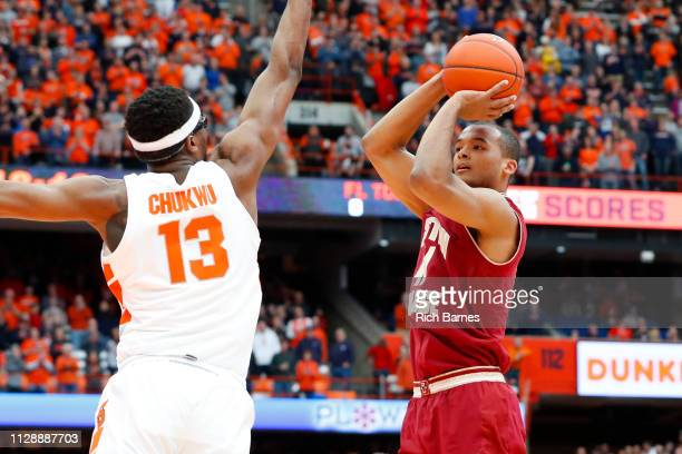 Steffon Mitchell of the Boston College Eagles shoots the ball as Paschal Chukwu of the Syracuse Orange defends during the first half at the Carrier...