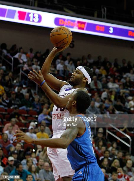 Stefhon Hannah of the Iowa Energy goes to the hoop in front of Brandon Brooks of the Tulsa 66ers during their game at the Wells Fargo Arena on April...