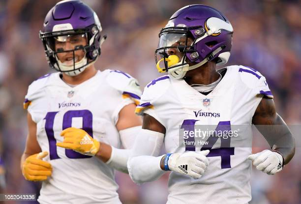 Stefon Diggs and Adam Thielen of the Minnesota Vikings come to the line of scrimmage against the Los Angeles Rams at Los Angeles Memorial Coliseum on...