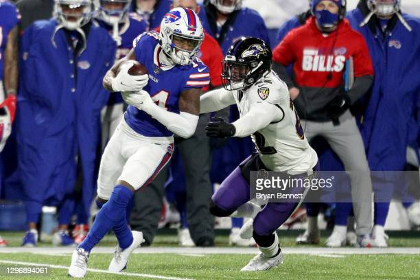 Stefon Diggs of the Buffalo Bills is tackled by Jimmy Smith of the Baltimore Ravens during the second quarter of an AFC Divisional Playoff game at...