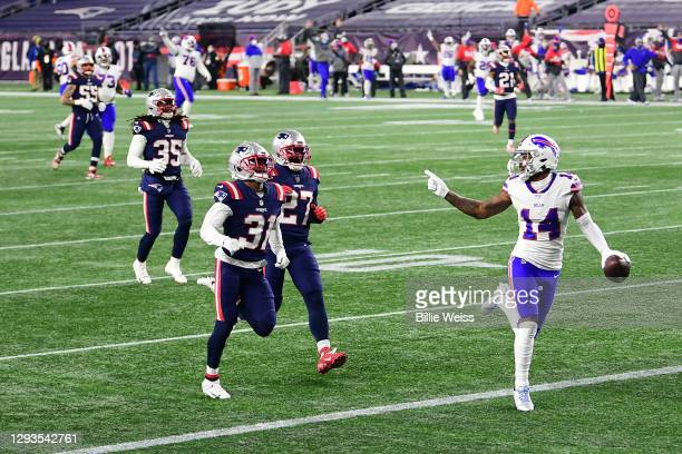 Stefon Diggs of the Buffalo Bills reacts as he runs into the end zone for a touchdown as Jonathan Jones and J.C. Jackson of the New England Patriots...