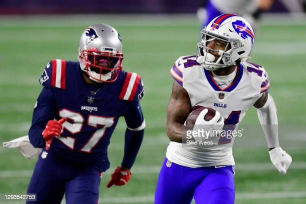 Stefon Diggs of the Buffalo Bills runs the ball into the end zone for a touchdown as J.C. Jackson of the New England Patriots gives chase during the...