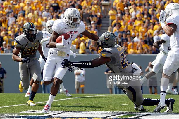 Stefon Diggs of the Maryland Terrapins carries the ball against Terence Garvin of the West Virginia Mountaineers during the game on September 22 2012...