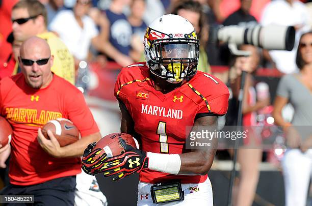 Stefon Diggs of the Maryland Terrapins runs down the sideline for a touchdown against the Old Dominion Monarchs at Byrd Stadium on September 7 2013...
