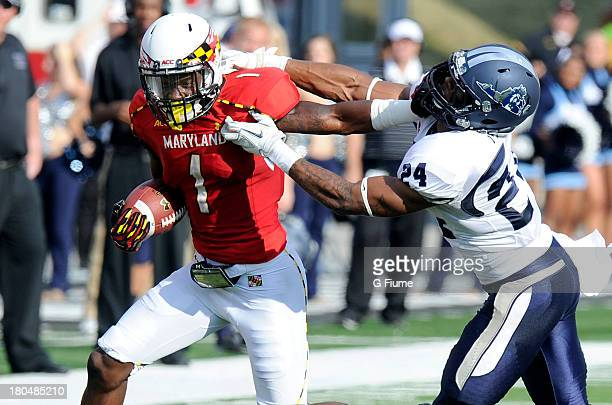 Stefon Diggs of the Maryland Terrapins stiff arms Fellonte Misher of the Old Dominion Monarchs at Byrd Stadium on September 7 2013 in College Park...