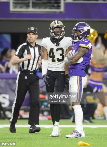 Stefon Diggs of the Minnesota Vikings and Marcus Williams of the New Orleans Saints react to a pass interference call during the first half of the...