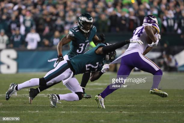 Stefon Diggs of the Minnesota Vikings attempts to get past the tackle attempt of Rodney McLeod of the Philadelphia Eagles during the first quarter in...