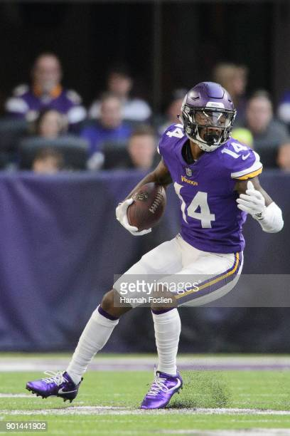 Stefon Diggs of the Minnesota Vikings carries the ball against the Chicago Bears during the game on December 31 2017 at US Bank Stadium in...