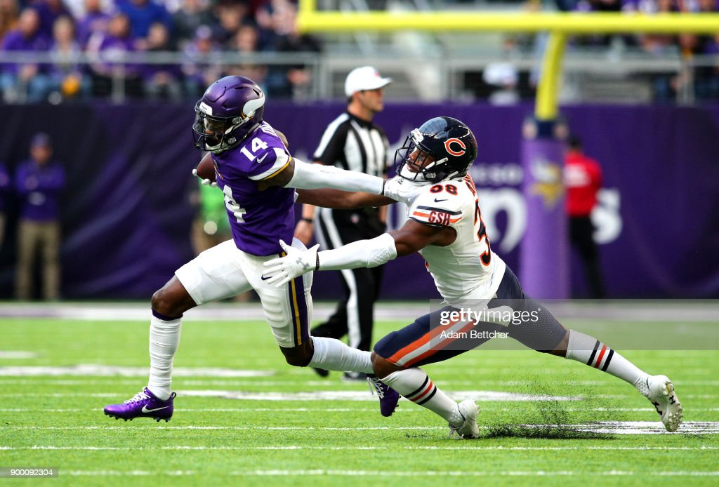 Stefon Diggs #14 of the Minnesota Vikings carries the ball and stiff arms Adrian Amos #38 of the Chicago Bears in the first quarter of the game on December 31, 2017 at U.S. Bank Stadium in Minneapolis, Minnesota.