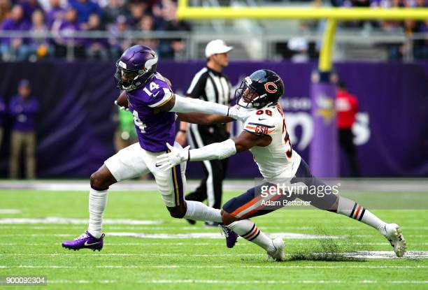 Stefon Diggs of the Minnesota Vikings carries the ball and stiff arms Adrian Amos of the Chicago Bears in the first quarter of the game on December...
