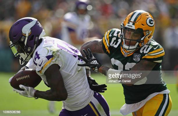 Stefon Diggs of the Minnesota Vikings catches a first down pass over Jaire Alexander of the Green Bay Packers at Lambeau Field on September 16 2018...