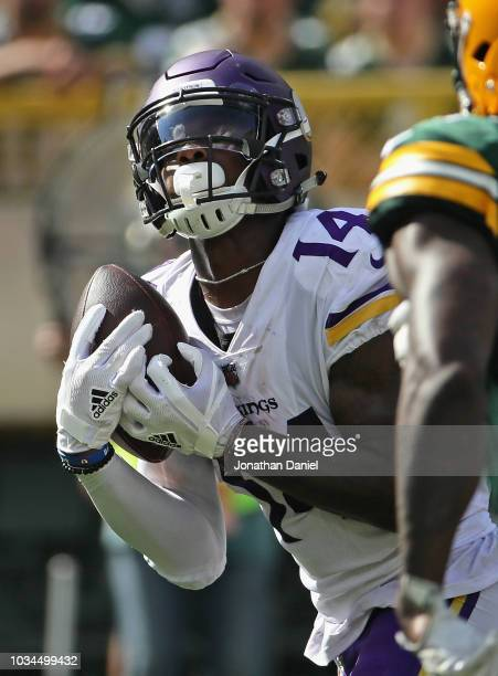 Stefon Diggs of the Minnesota Vikings catches a touchdown pass against the Green Bay Packers in the 4th quarter at Lambeau Field on September 16 2018...