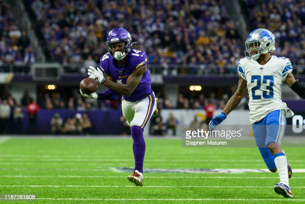Stefon Diggs of the Minnesota Vikings catches the ball for a 44 yard reception as he's pursued by defender Darius Slay of the Detroit Lions in the...