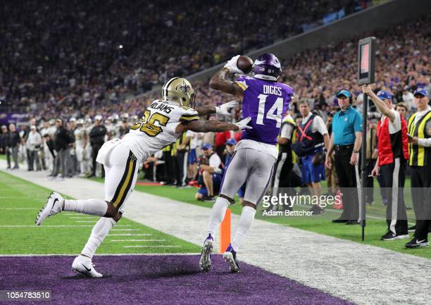 Stefon Diggs of the Minnesota Vikings catches the ball for a touchdown in the first quarter of the game against the New Orleans Saints at US Bank...