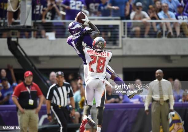 Stefon Diggs of the Minnesota Vikings catches the ball for a touchdown over defender Vernon Hargreaves of the Tampa Bay Buccaneers in the second...