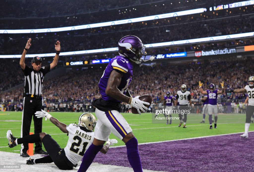 Stefon Diggs #14 of the Minnesota Vikings celebrates after catching a touchdown at the end of the first half of the game against the New Orleans Saints on September 11, 2017 at U.S. Bank Stadium in Minneapolis, Minnesota.
