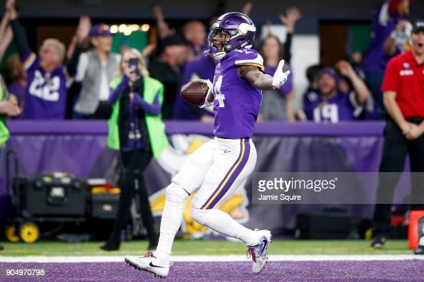 Stefon Diggs of the Minnesota Vikings celebrates after scoring a touchdown to defeat the New Orleans Saints in the NFC Divisional Playoff game at US...