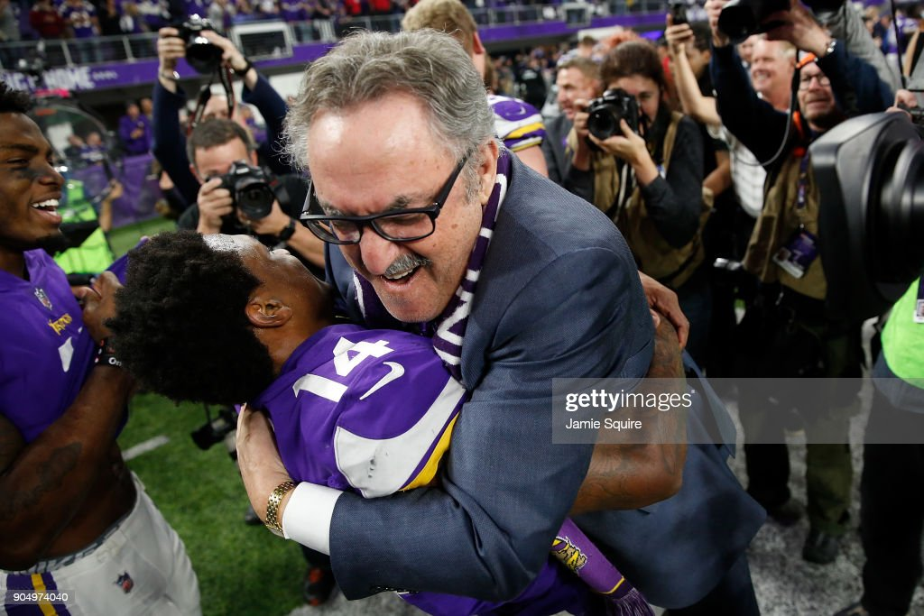 Stefon Diggs #14 of the Minnesota Vikings celebrates with owner Zygi Wilf after defeating the New Orleans Saints in the NFC Divisional Playoff game at U.S. Bank Stadium on January 14, 2018 in Minneapolis, Minnesota.