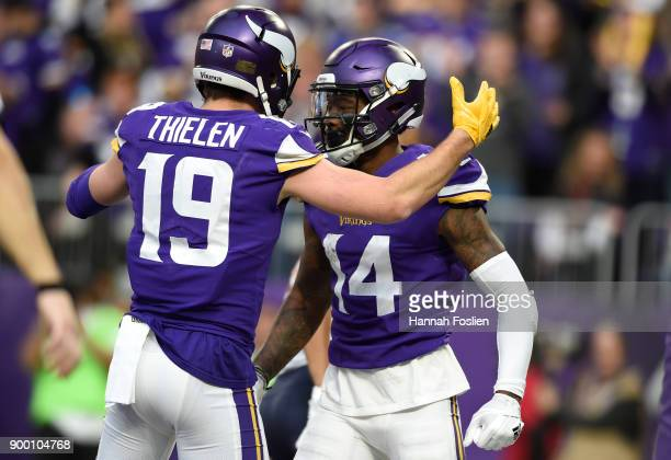 Stefon Diggs of the Minnesota Vikings celebrates with teammate Adam Thielen after scoring a touchdown in the third quarter of the game against the...