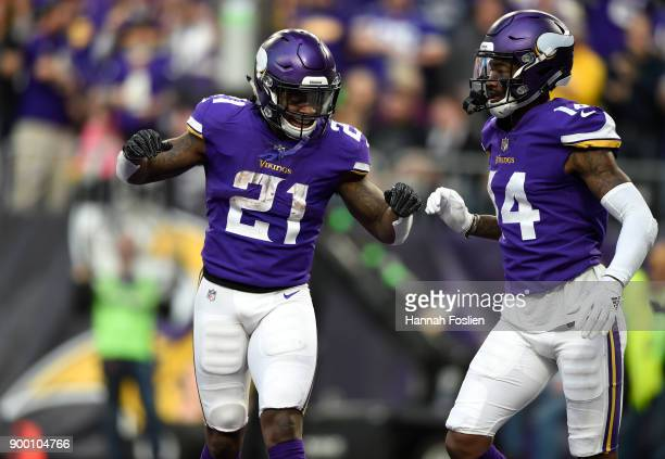 Stefon Diggs of the Minnesota Vikings celebrates with teammate Jerick McKinnon after scoring a touchdown in the third quarter of the game against the...