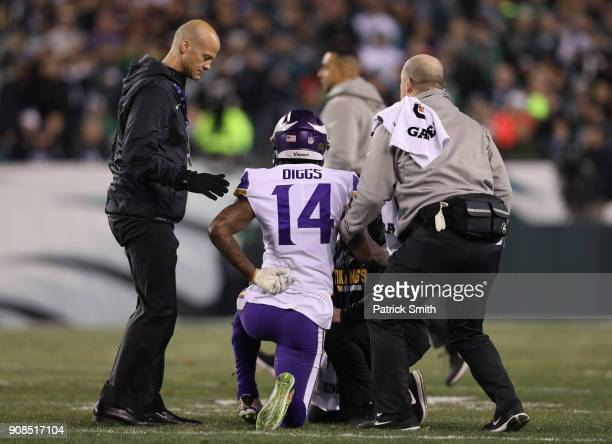 Stefon Diggs of the Minnesota Vikings is looked at by the trainers during the first quarter against the Philadelphia Eagles in the NFC Championship...