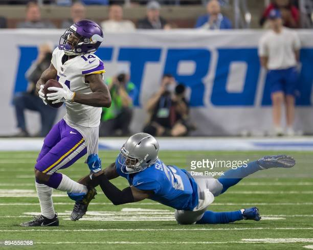 Stefon Diggs of the Minnesota Vikings is tackled by Darius Slay of the Detroit Lions during an NFL game at Ford Field on November 23 2016 in Detroit...