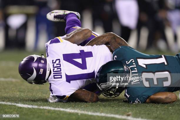 Stefon Diggs of the Minnesota Vikings is tackled by Jalen Mills of the Philadelphia Eagles during the second quarter in the NFC Championship game at...