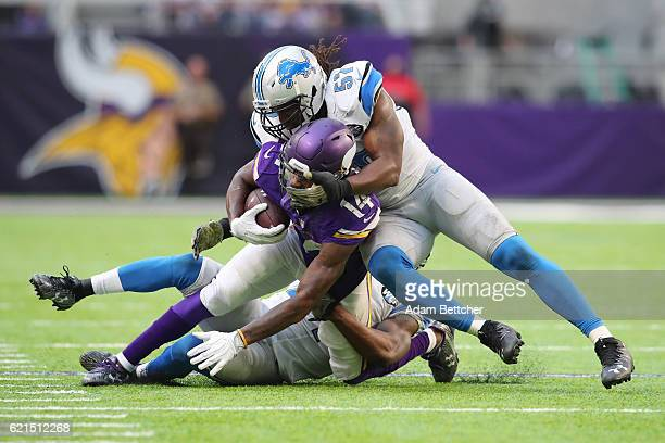 Stefon Diggs of the Minnesota Vikings is tackled by Nevin Lawson and Josh Bynes of the Detroit Lions of the game on November 6, 2016 at US Bank...