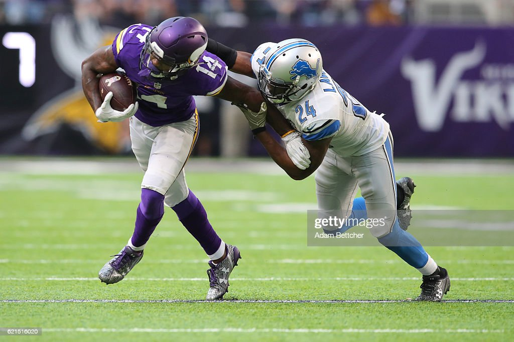 Stefon Diggs #14 of the Minnesota Vikings is wrapped up by Nevin Lawson #24 of the Detroit Lions during their game on November 6, 2016 at US Bank Stadium in Minneapolis, Minnesota.