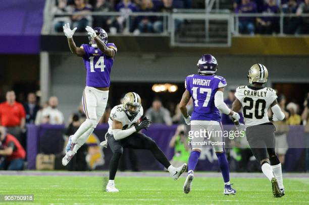 Stefon Diggs of the Minnesota Vikings jumps to make a catch over Marcus Williams of the New Orleans Saints as Jarius Wright of the Minnesota Vikings...