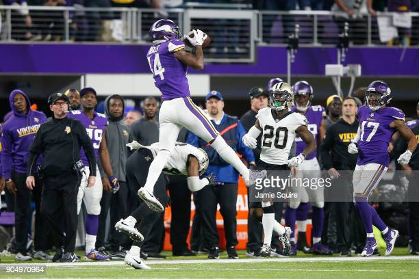 Stefon Diggs of the Minnesota Vikings makes a catch over Marcus Williams of the New Orleans Saints during the second half of the NFC Divisional...