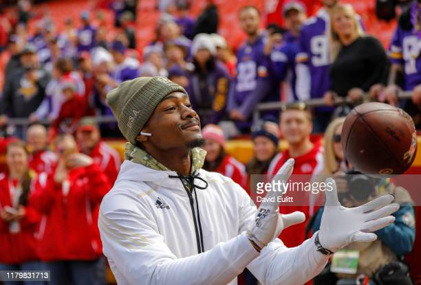 Stefon Diggs of the Minnesota Vikings plays catch with Minnesota Vikings fans in attendance prior to the game against the Kansas City Chiefs at...