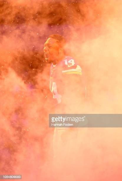 Stefon Diggs of the Minnesota Vikings runs out of the tunnel during pregame introductions before the game against the New Orleans Saints at US Bank...