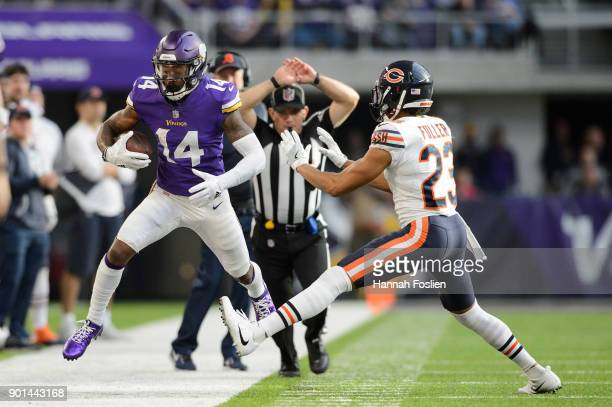 Stefon Diggs of the Minnesota Vikings runs the ball out of bounds against Kyle Fuller of the Chicago Bears during the game on December 31 2017 at US...